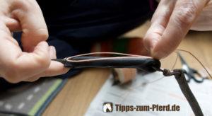 Peitsche mit angeklebter Ersatzschlaufe und einer Fadenschlaufe um mit einer Takelung zu beginnen